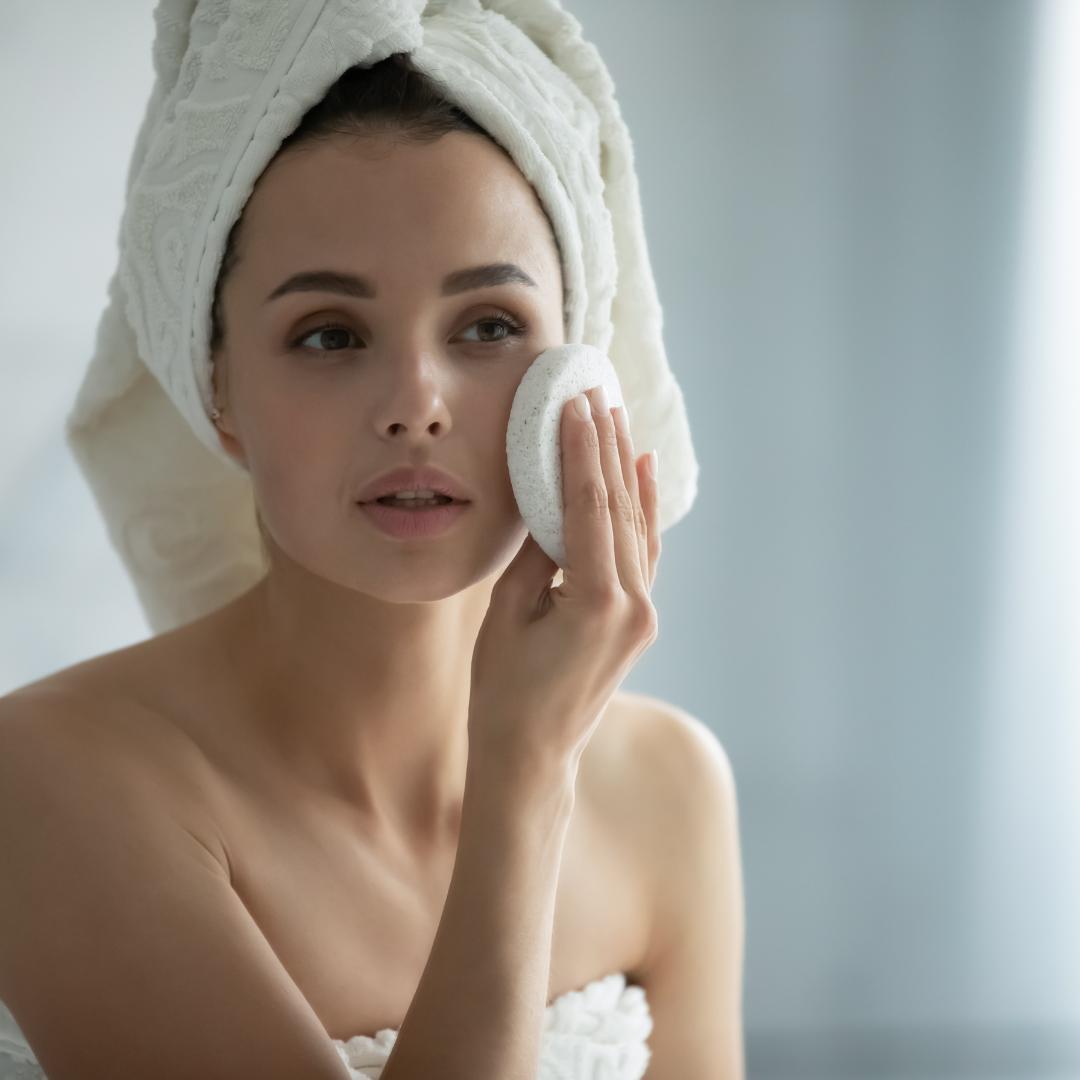Woman in bathroom enjoying a professional facial at home