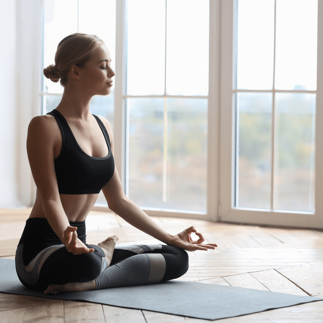 woman meditating on yoga mat to help boost inner confidence